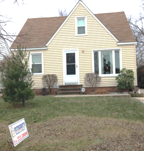 New Vinyl Siding with Double-Hung & Triple Casement Windows
